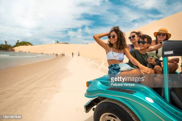 buggy ride in genipabu beach - natal brazil stock pictures, royalty-free photos & images