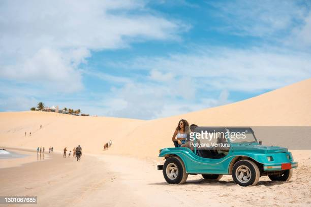 buggy ride on the dunes in genipabu, rio grande do norte - natal brazil stock pictures, royalty-free photos & images