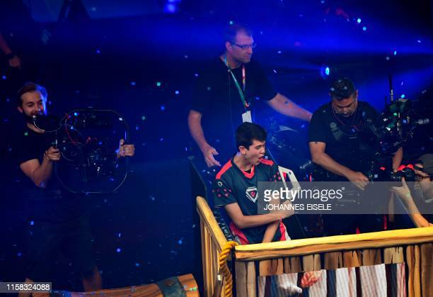 TOPSHOT Bugha of the US celebrates after winning the final of the Solo competition at the 2019 Fortnite World Cup July 28 2019 inside of Arthur Ashe...