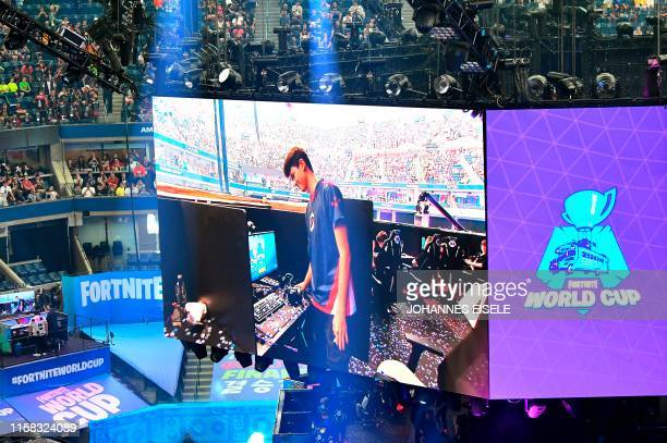 Bugha of the US celebrates after winning the final of the Solo competition at the 2019 Fortnite World Cup July 28, 2019 inside of Arthur Ashe...