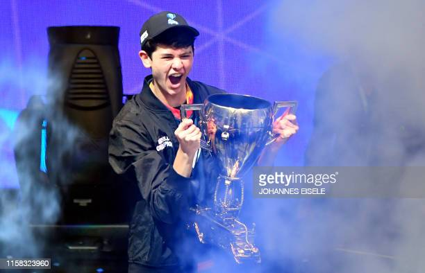Bugha of the US celebrates with the trophy after winning the final of the Solo competition at the 2019 Fortnite World Cup July 28 2019 inside of...