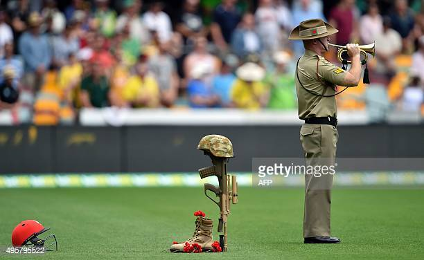Bugler from the Australian Army plays to commemorate the 100th anniversary of the 1915 ANZAC landing at Gallipoli prior to the day one game of the...