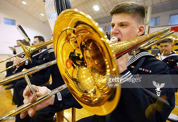 Bugler from the USS Blue Ridge plays a trombone ahead a friendly basketball match between the Chinese navy's team and the Blue Ridge team in...