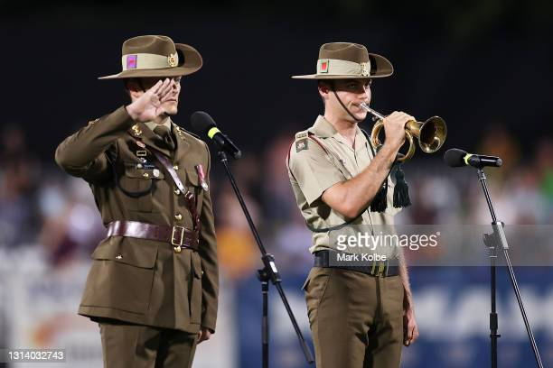 Bugler plays during an ANZAC ceremony before the round seven NRL match between the Parramatta Eels and the Brisbane Broncos at TIO Stadium, on April...