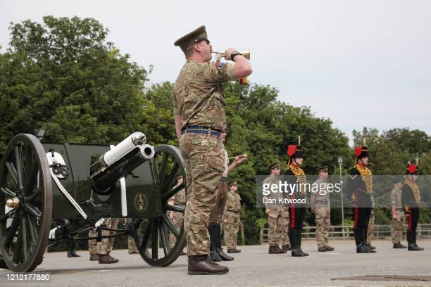 Bugler plays the Last Post as the King's Troop Royal Horse Artillery carry out a socially distanced parade of 20 soldiers with their first world war...
