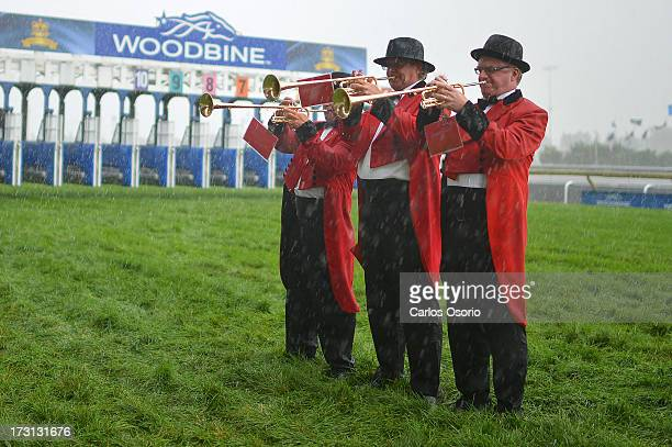 Buglers play during a downpour at Sunday's Queen's Plate at Woodbine racetrack