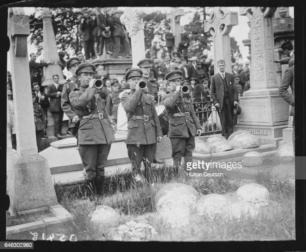 Buglers play the Last Post at the 1922 funeral of Joseph McGuiness