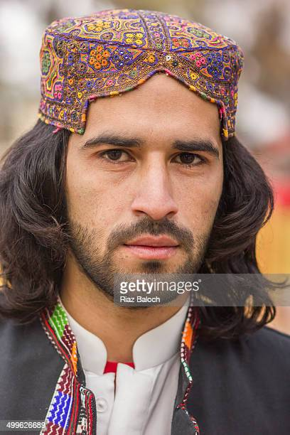 bugti cap and waistcoat - handsome pakistani men stock photos and pictures