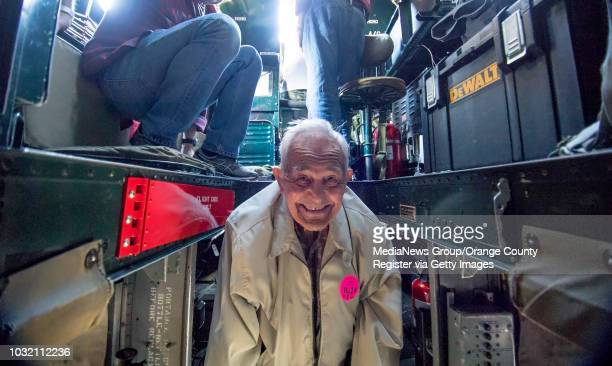 Buhl Palmer grins after squeezing himself along a catwalk to get to the front of a B24 Liberator while it flies over Orange County on Friday May 12...