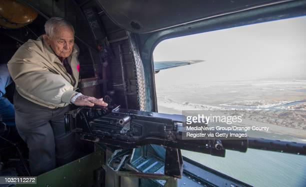 Buhl Palmer takes a moment to look at a machine gun in the window B24 Liberator while it flies over Orange County on Friday May 12 2017 Palmer worked...