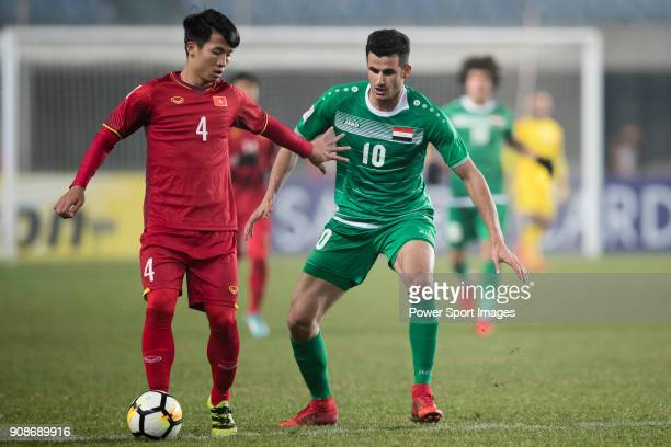 Bui Tien Dung II of Vietnam fights for the ball with Aymen Hussein of Iraq during the AFC U23 Championship China 2018 Quarterfinals match between...
