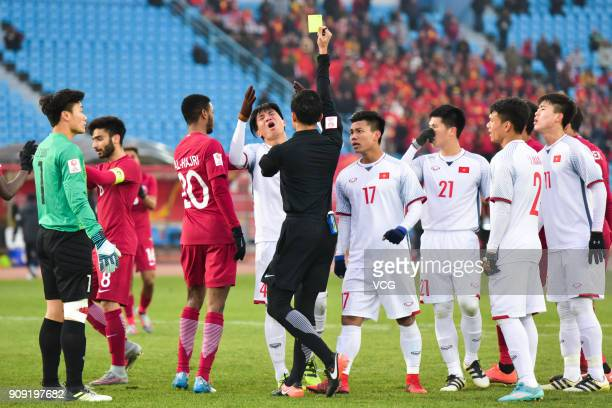 Bui Tien Dung II of Vietnam receives a yellow card from the referee during the AFC U23 Championship semifinal match between Qatar and Vietnam at...
