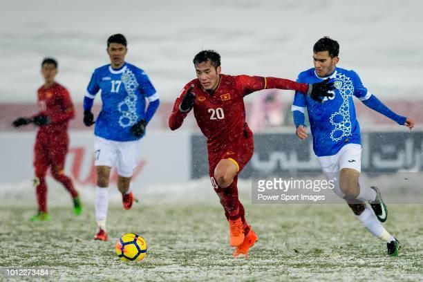 Bui Tien Dung of Vietnam plays against Doniyorjon Narzullaev of Uzbekistan during the AFC U23 Championship China 2018 match between Vietnam and...