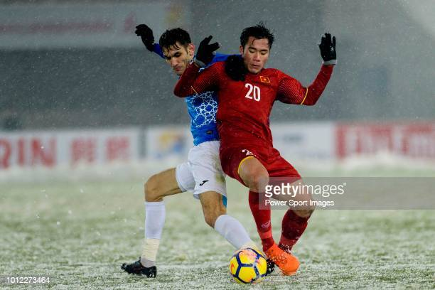 Bui Tien Dung of Vietnam plays against Zabikhillo Urinboev of Uzbekistan during the AFC U23 Championship China 2018 match between Vietnam and...
