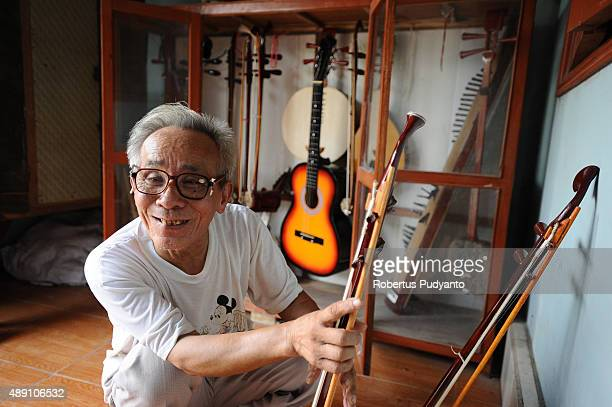 Bui Van Vuoc shows the traditional music instruments at his gallery in Vinh Bao on September 19 2015 in Hai Phong Vietnam 81yearsold Bui Van Vuoc of...