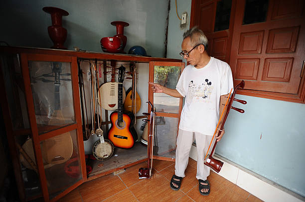 Bui Van Vuoc shows traditional music instruments at his gallery in Vinh Bao on September 19 2015 in Hai Phong Vietnam 81yearsold Bui Van Vuoc of Bao...