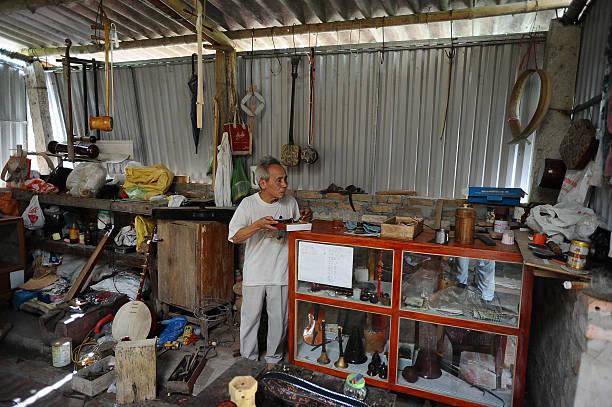 Bui Van Vuoc works at his workshop in Vinh Bao on September 19 2015 in Hai Phong Vietnam 81yearsold Bui Van Vuoc of Bao Ha Dong Minh Commune Vinh Bao...