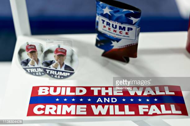 A Build The Wall And Crime Will Fall sticker sits on display at a both during the Conservative Political Action Conference in National Harbor...