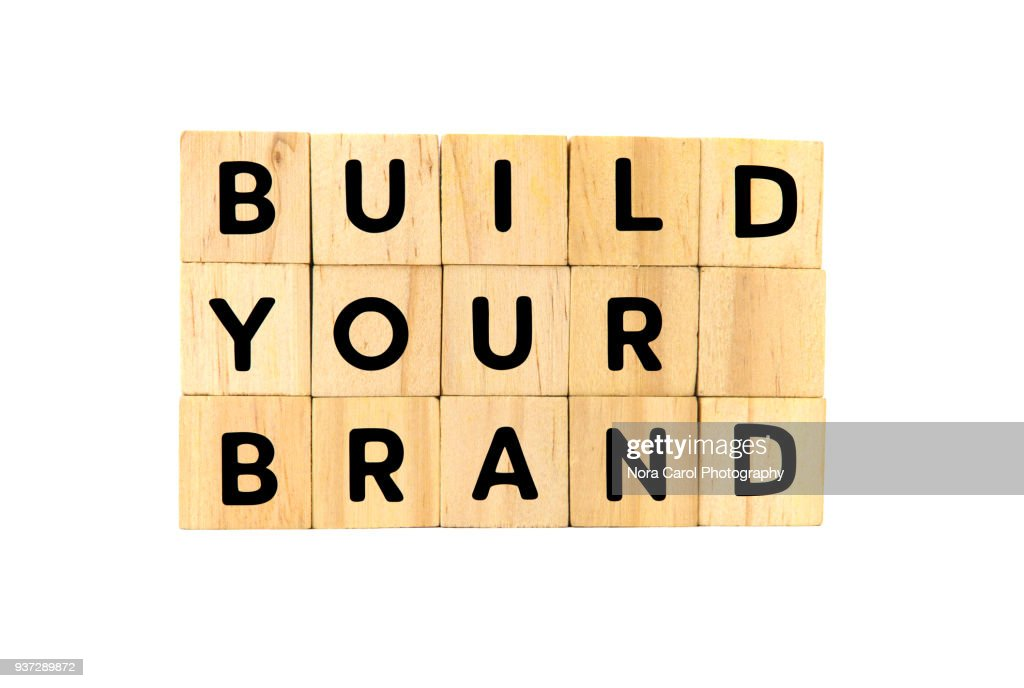 Build Your Brand Text on Wooden Blocks on White Background : ストックフォト