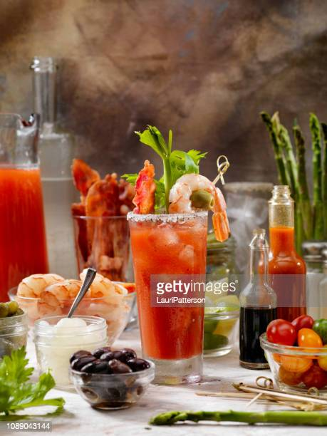 build your own bloody mary bar with, bacon, shrimp,celery, asparagus. - bloody mary stock photos and pictures