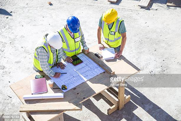 Builder and architect  on building site
