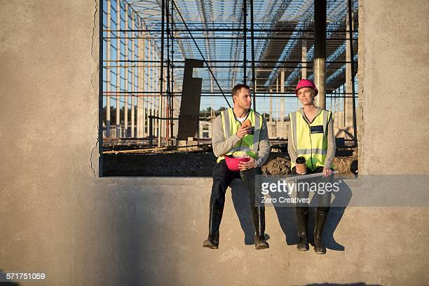 Builder and architect taking a break on construction site