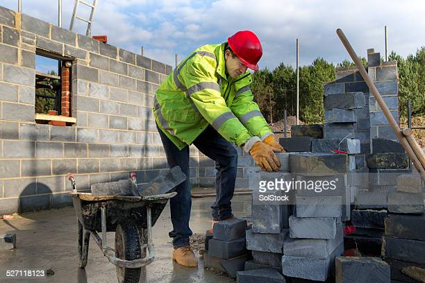 Builder Stacking Bricks