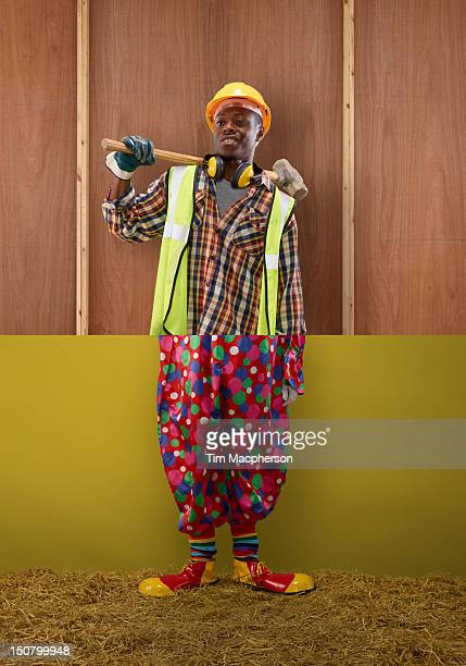 builder top, clown bottom - black cheerleaders stock photos and pictures