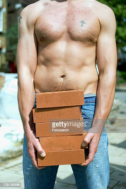 builder with bare chest - chest barechested bare chested stock-fotos und bilder