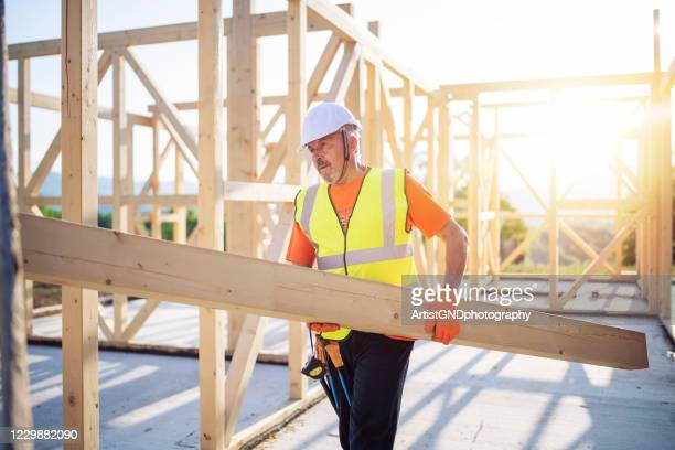 builder working on wooden house - independence stock pictures, royalty-free photos & images