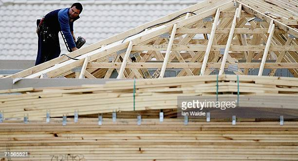 A builder works on a house under construction amongst an established suburb August 2 2006 in Sydney Australia The Reserve Bank of Australia today...