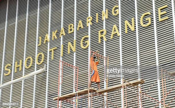A builder works on a scaffold at a shooting range in Palembang in Indonesia's South Sumatra province on Nov 28 2017 The venue for the 2018 Asian...