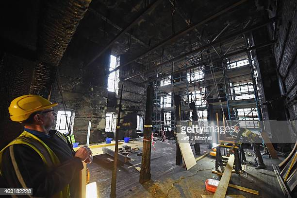 Builders at work in the Glasgow School of Art Mackintosh Library on February 11 2015 in Glasgow Scotland Stabilising work continues following the...