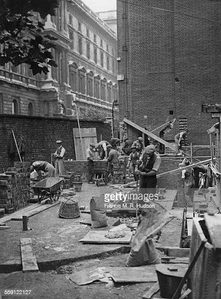 Builders at work on an extension to the gardens of the British Prime Minister's residence at 10 Downing Street London 21st August 1936