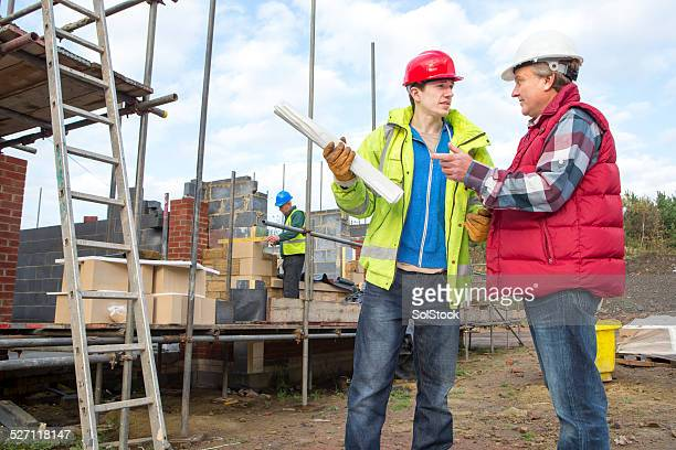 Builders Discussing Building Plans