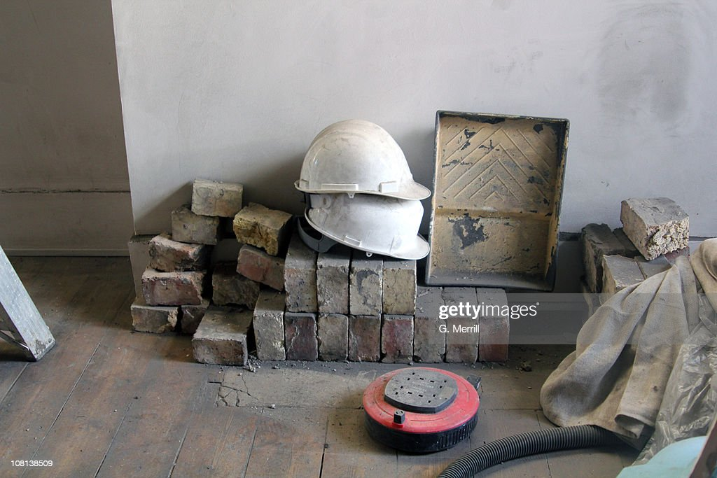 Builders equipment leaning against wall : Stock Photo