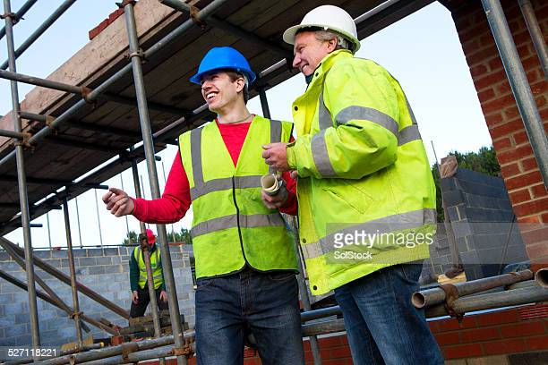 Builders Happily Discussing Building Plans