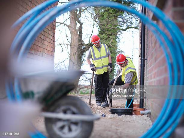 Builders installing water pipes