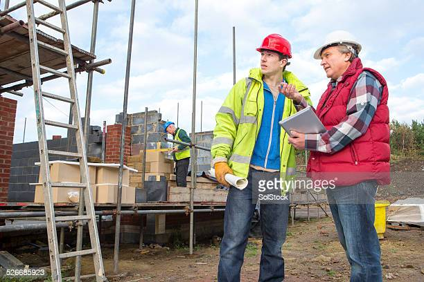Builders Looking at Digital Tablet