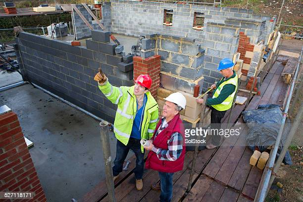 Builders Looking at the Building Site