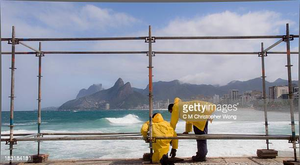 Builders were setting up temporary shelter for press for an Internation surfing competition in Ipanema Beach, Rio de Janeiro, framed up the Two...
