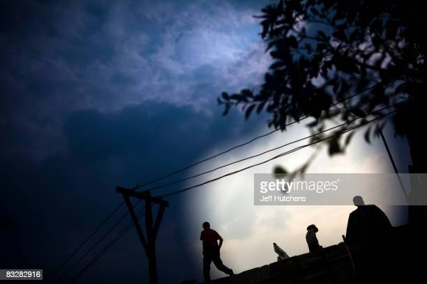 Builders work in the streets of a newly created town built to house forcibly relocated residents whose homes are being intentionally flooded during...