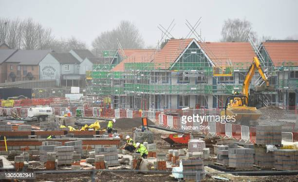 Builders work on a 7.8 million housing estate by construction company Seddon, creating 63 new homes on March 03, 2021 in Burslem, England. UK...