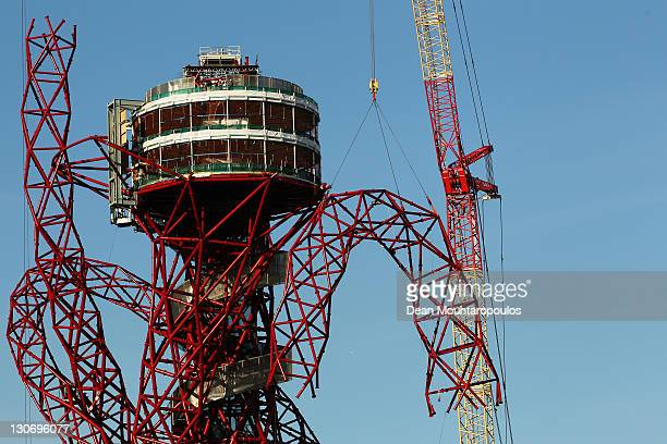 Builders work on lowering the final piece to get the London 2012 ArcelorMittal Orbit sculpture completed at the Olympic Park on October 28 2011 in...