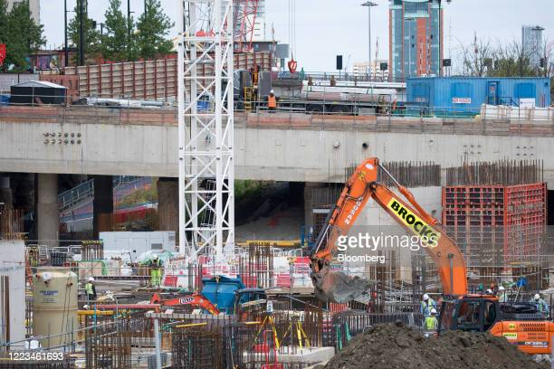 Builders work on the site of Wood Wharf a development by the Canary Wharf Group in the Canary Wharf business financial shopping district in London UK...