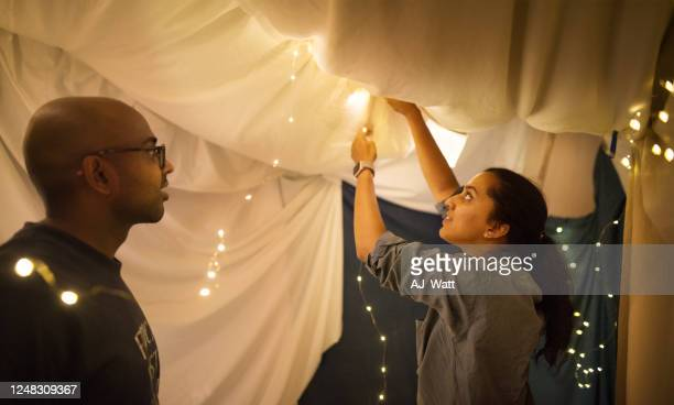 building a blanket fort inside home - fortress stock pictures, royalty-free photos & images