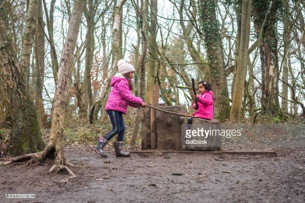 building a den in the woods - brown shoe stock pictures, royalty-free photos & images