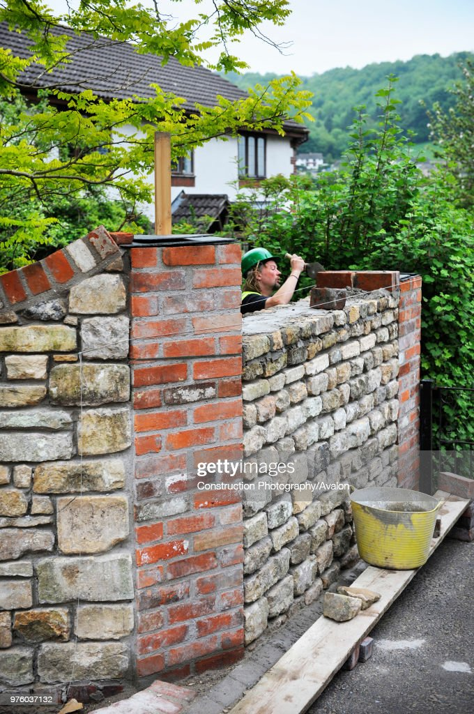 Building A Garden Wall With Cotswold Stone And Cement Mortar With