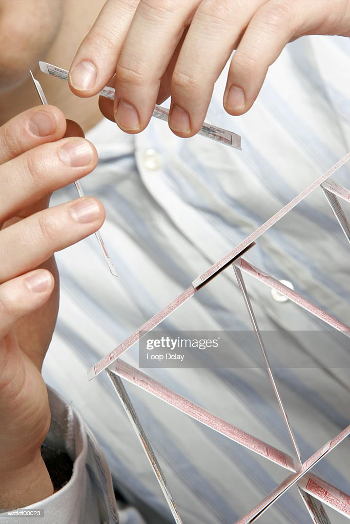 Building a house of cards : Stock Photo