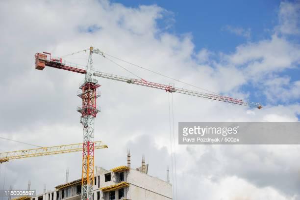 building a house with construction cranes - pavel foundation stock-fotos und bilder